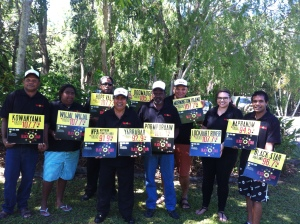 QRAM Board Staff Holding Network Signs