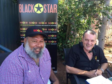 Councilor Eddie Newman speaks to Greg Reid on Black Star